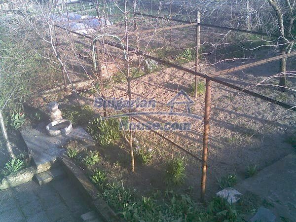 11044:11 - Pretty brick house with a garden featuring many fruit trees