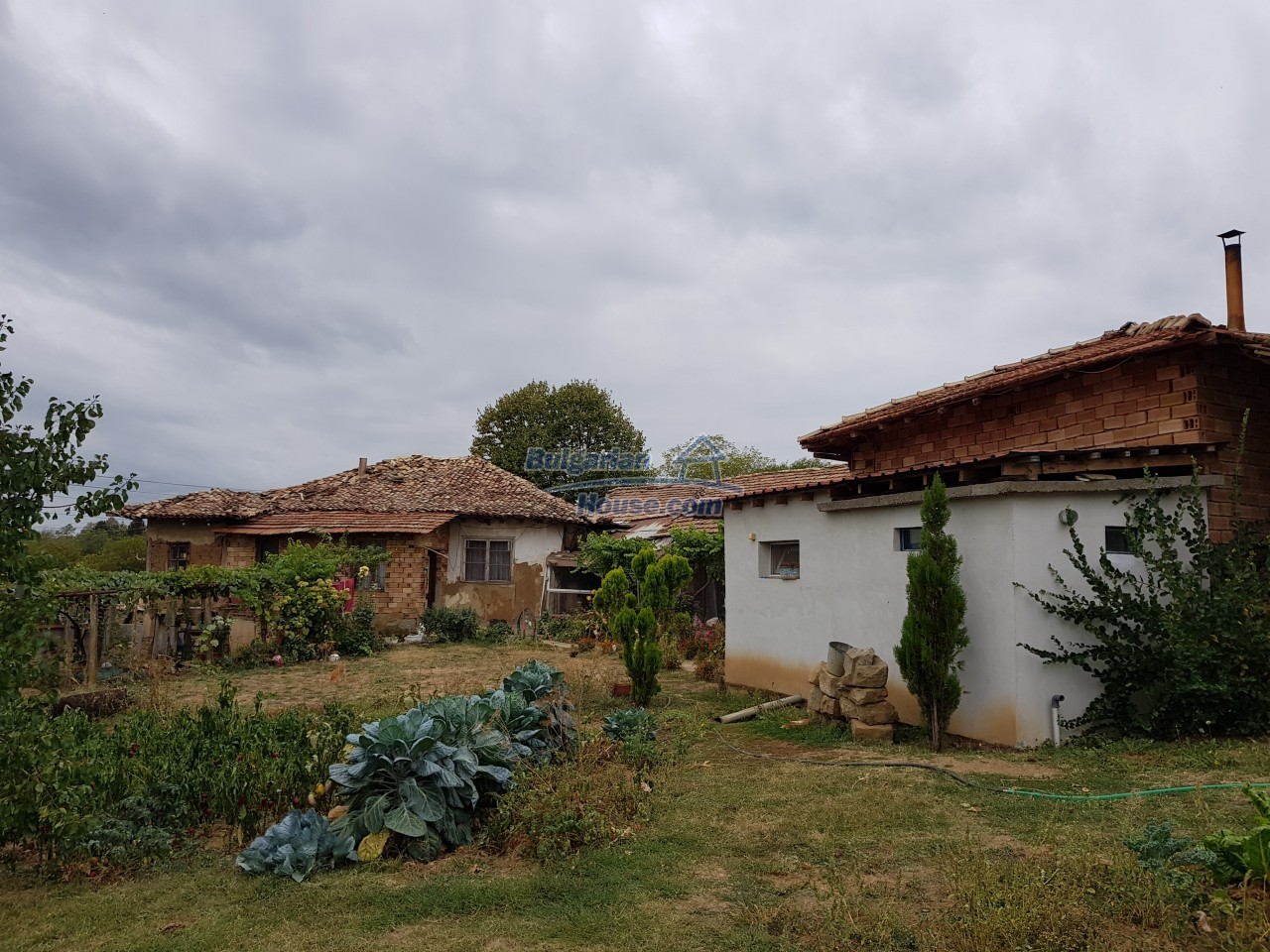 12962:8 - TWO HOUSES, big workshop, many outbuildings and 5000sq.m garden